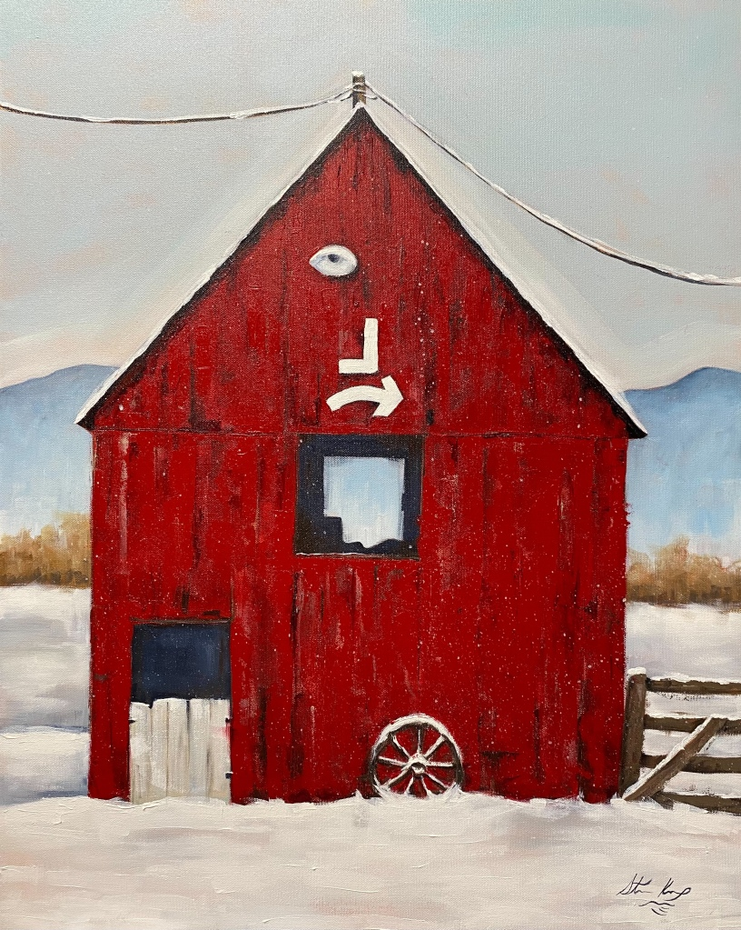 Red barn in snow with a brand of a backwards L and an arrow pointing to the right on it.